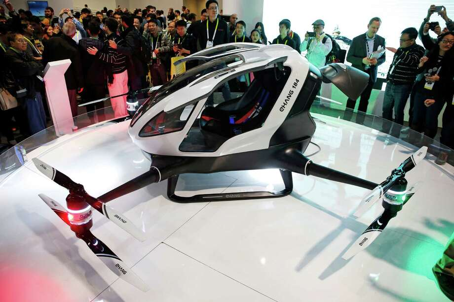 The EHang 184 autonomous aerial vehicle is unveiled at the EHang booth at CES International, Wednesday, Jan. 6, 2016, in Las Vegas. The drone is large enough to fit a human passenger. (AP Photo/John Locher) Photo: John Locher, STF / Associated Press / AP