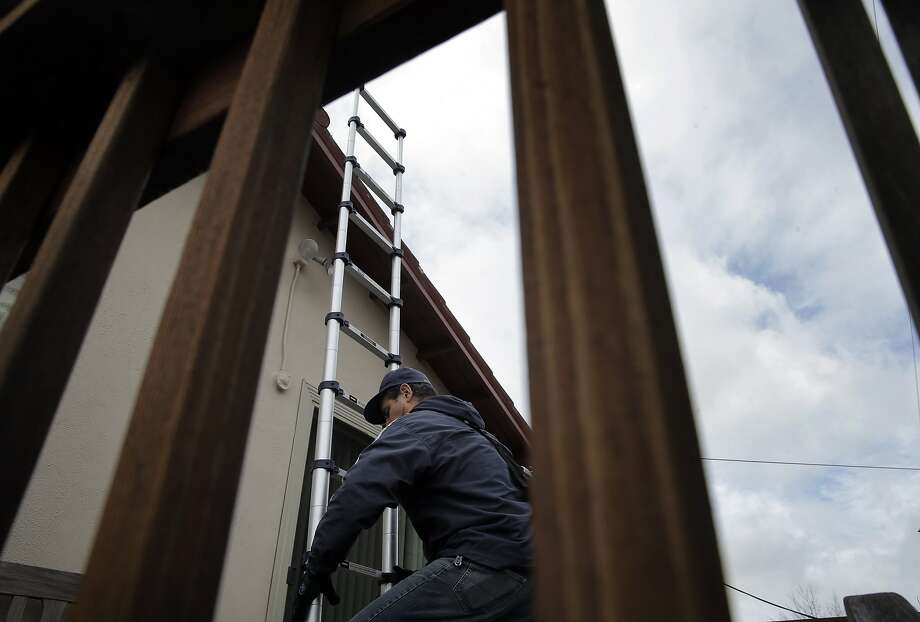 Ricardo Molina of Mr. Roofers, sets up his collapsable ladder before he checked the roof of Novella Jefferson's home in San Bruno, Calif., on Wednesday, January 6, 2016.  Some businesses have seen up uptick in work due to the arrival of storms from El Niño. Photo: Carlos Avila Gonzalez, The Chronicle