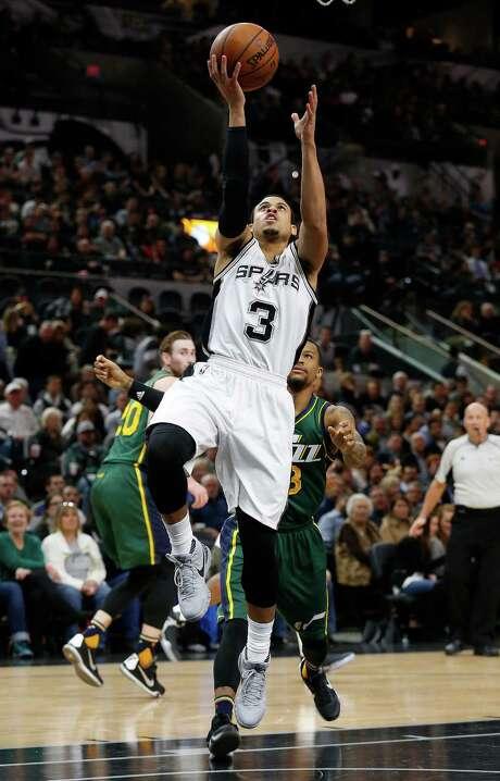 Spurs' Ray McCallum (03) drives past against Utah Jazz's Trey Burke (03) on Wednesday, Jan. 6, 2016. Photo: Kin Man Hui, San Antonio Express-News / ©2016 San Antonio Express-News