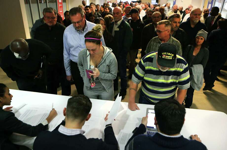 Uber drivers and potential drivers sign in before attending an Uber press conference at TriPoint Event Center on Wednesday, Jan. 6, 2016. Close to 300 drivers attended the event. Photo: BOB OWEN, Staff / San Antonio Express-News / San Antonio Express-News