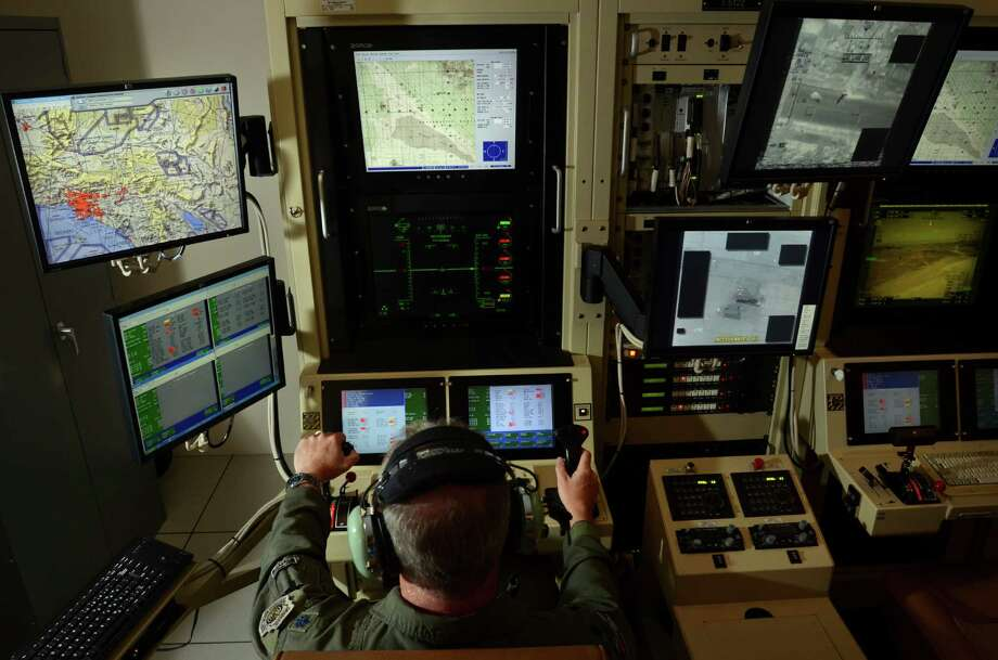 A pilot works the controls of a remotely-piloted aircraft from Hancock Field Air National Guard Base in Upstate New York. Photo: Heather Ainsworth /New York Times / NYTNS