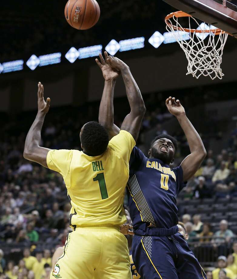 Oregon's Jordan Bell (left) and Cal's Jaylen Brown vie for a re bound in the first half, when the Bears held the Ducks' scor ing down before letting them shoot 52 percent in the second half. Photo: Ryan Kang, Associated Press