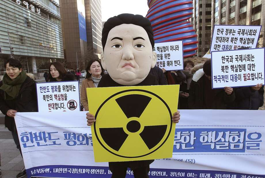 "A South Korean university student wearing a mask depicting North Korean leader Kim Jong Un participates in a rally against North Korea's announcement that it had tested a hydrogen bomb in Seoul, South Korea, Thursday, Jan. 7, 2016. North Korea's declaration that it had tested a hydrogen bomb for the first time was greeted with widespread condemnation - but also skepticism  - as world powers vowed Wednesday to punish the impoverished and defiant nation with new international sanctions. The banners read "" We denounce North Korea' nuclear test."" (AP Photo/Ahn Young-joon) Photo: Ahn Young-joon, Associated Press"