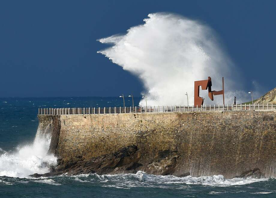 A picture taken on January 5, 2016 shows waves hitting a reataining wall in the northern Spanish city of San Sebastian. Alerts have been issued for dangerous waves along the Basque coast. Photo: Ander Gillenea, AFP / Getty Images