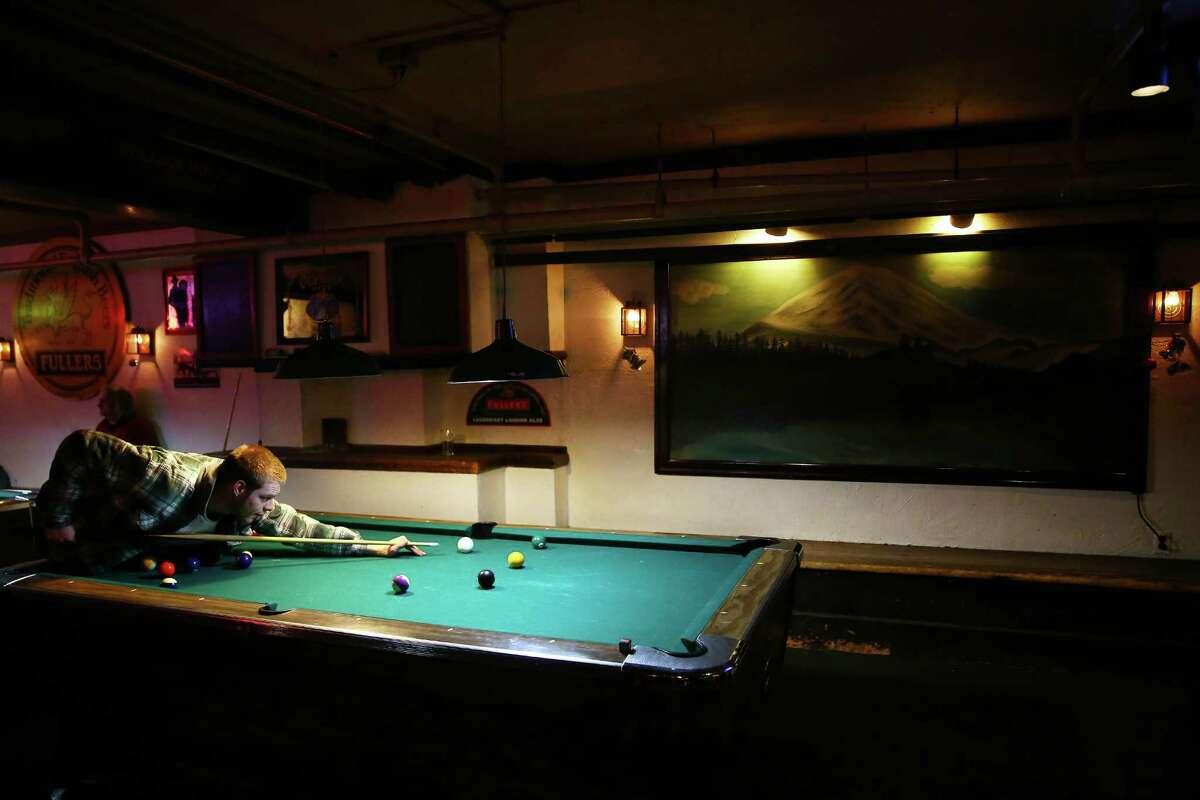 Aaron Tevaney plays pool at the College Inn Pub, Jan. 3, 2016.