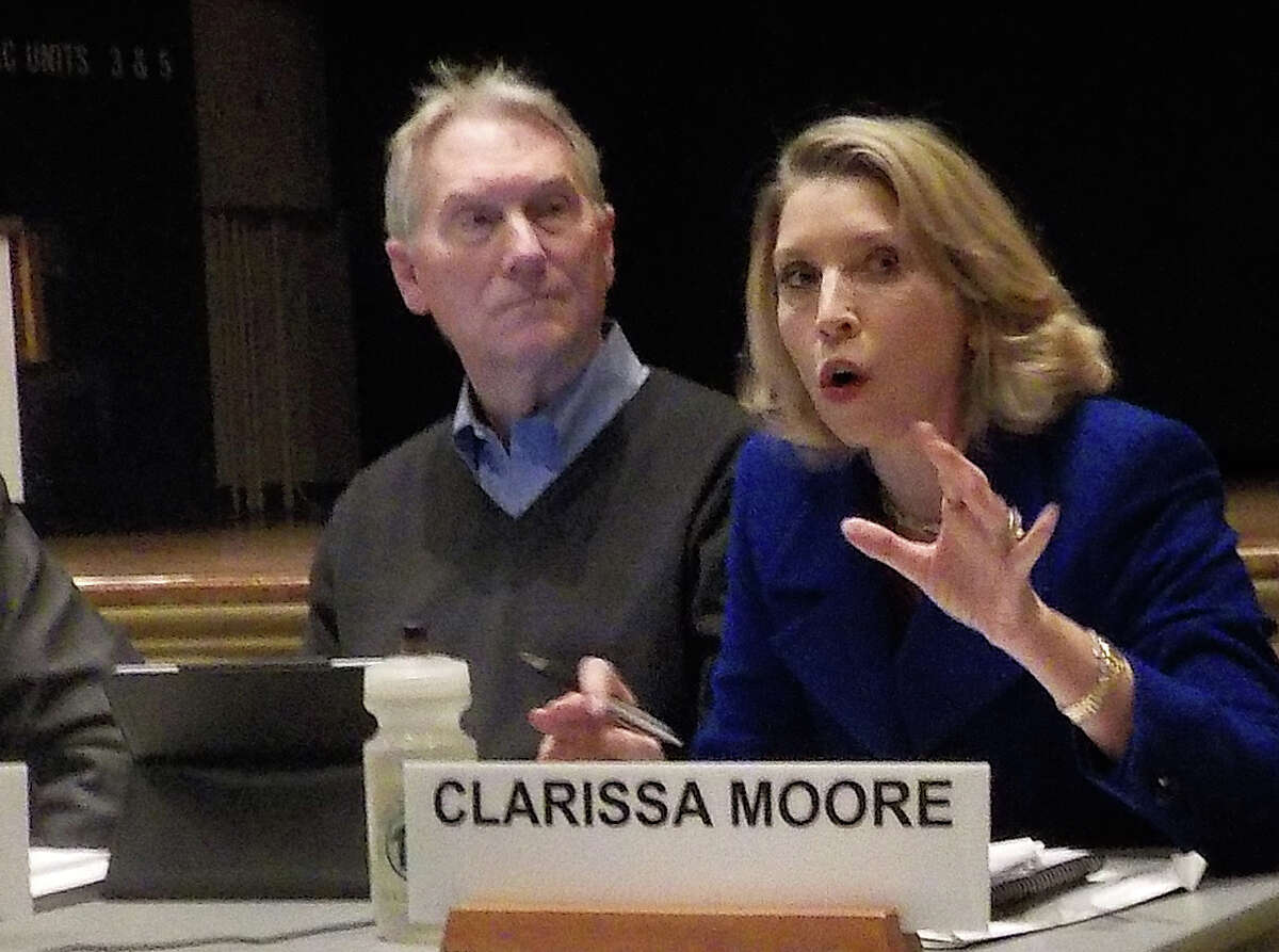 Board of Finance member Clarissa Moore asks Board of Education Chairman Michael Gordon, not pictured, why it took 10 years to install air conditioning in Coleytown Elementary School's gymnasium, auditorium and cafeteria. Looking on is finance board member John Hartwell.