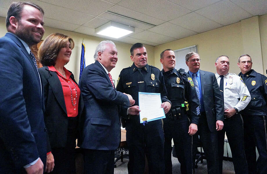 "First Selectman Mike Tetreau presented Police Chief Gary MacNamara with a proclamation declaring Saturday ""National Law Enforcement Appreciation Day"" at Wednesday's Board of Selectmen meeting. Photo: Genevieve Reilly / Hearst Connecticut Media / Fairfield Citizen"