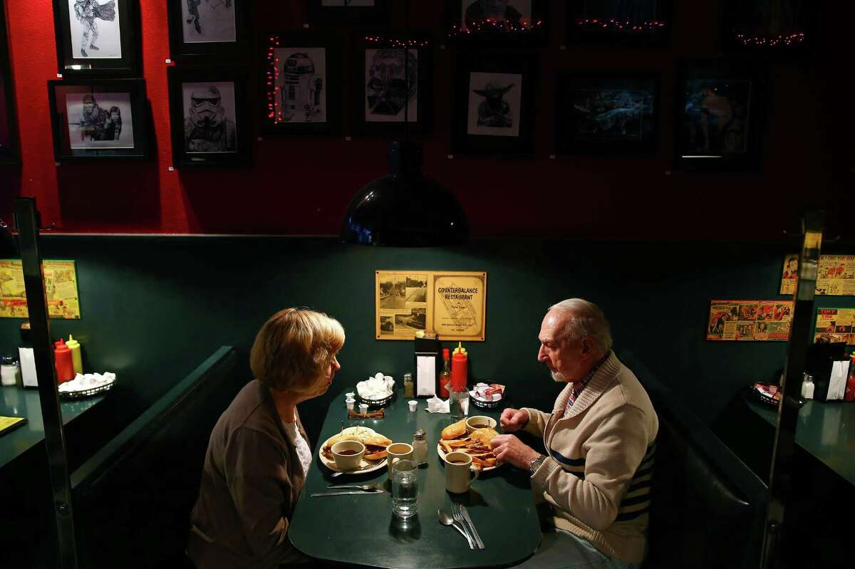 Paula and Dick McBrady eat lunch at the Mecca Cafe, Dec. 15, 2015. The Mecca has been family owned since it opened in 1930 in Lower Queen Anne.