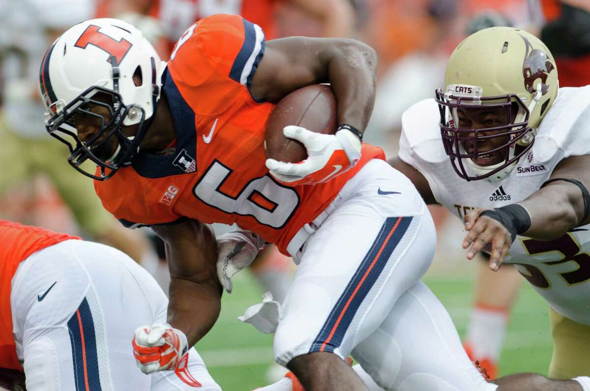 September 20, 2014: Illinois Fighting Illini running back Josh Ferguson (6) is pursued by Texas State Bobcats defensive tackle Will Trevillion (53) during the game between the Illinois Fighting Illini and the Texas State Bobcats at Memorial Stadium in Champaign, IL.