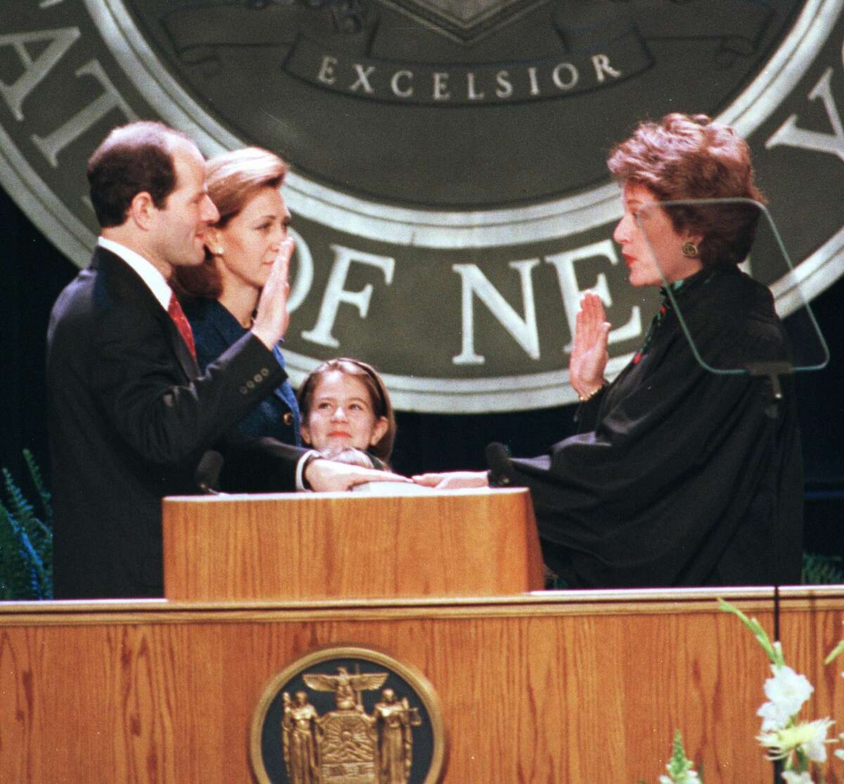 Attorney General Eliot Spitzer takes the oath of office from Court of Appeals Chief Judge Judith Kaye as his wife Silda and his oldest daughter look on Friday Jan. 1, 1999, at the Empire State Plaza Convention Center in Albany. (Skip Dickstein/Times Union)