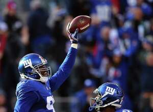 EAST RUTHERFORD, NJ - DECEMBER 06:  Jason Pierre-Paul #90 of the New York Giants celebrates after recovering a fumble in the second quarter against the New York Jets at MetLife Stadium on December 6, 2015 in East Rutherford, New Jersey.  (Photo by Elsa/Getty Images) ORG XMIT: 587435561