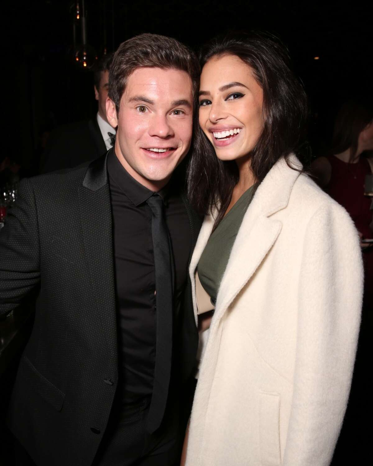 Actors Adam DeVine (L) and Chloe Bridges attend DailyMail's after party for 2016 People's Choice Awards at Club Nokia on Jan. 6, 2016 in Los Angeles, Calif.