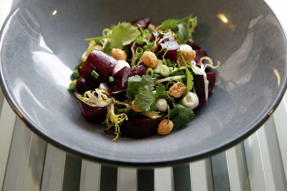 Charred beets with crème fraîche, malted peanuts, cilantro, curly endive and preserved lemon. Photo: Kin Man Hui /San Antonio Express-News / ©2016 San Antonio Express-News
