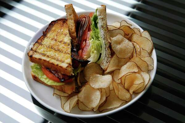 The GBLT with herbed goat cheese, tomato, bacon, Bibb lettuce with a verjus aioli and potato chips.