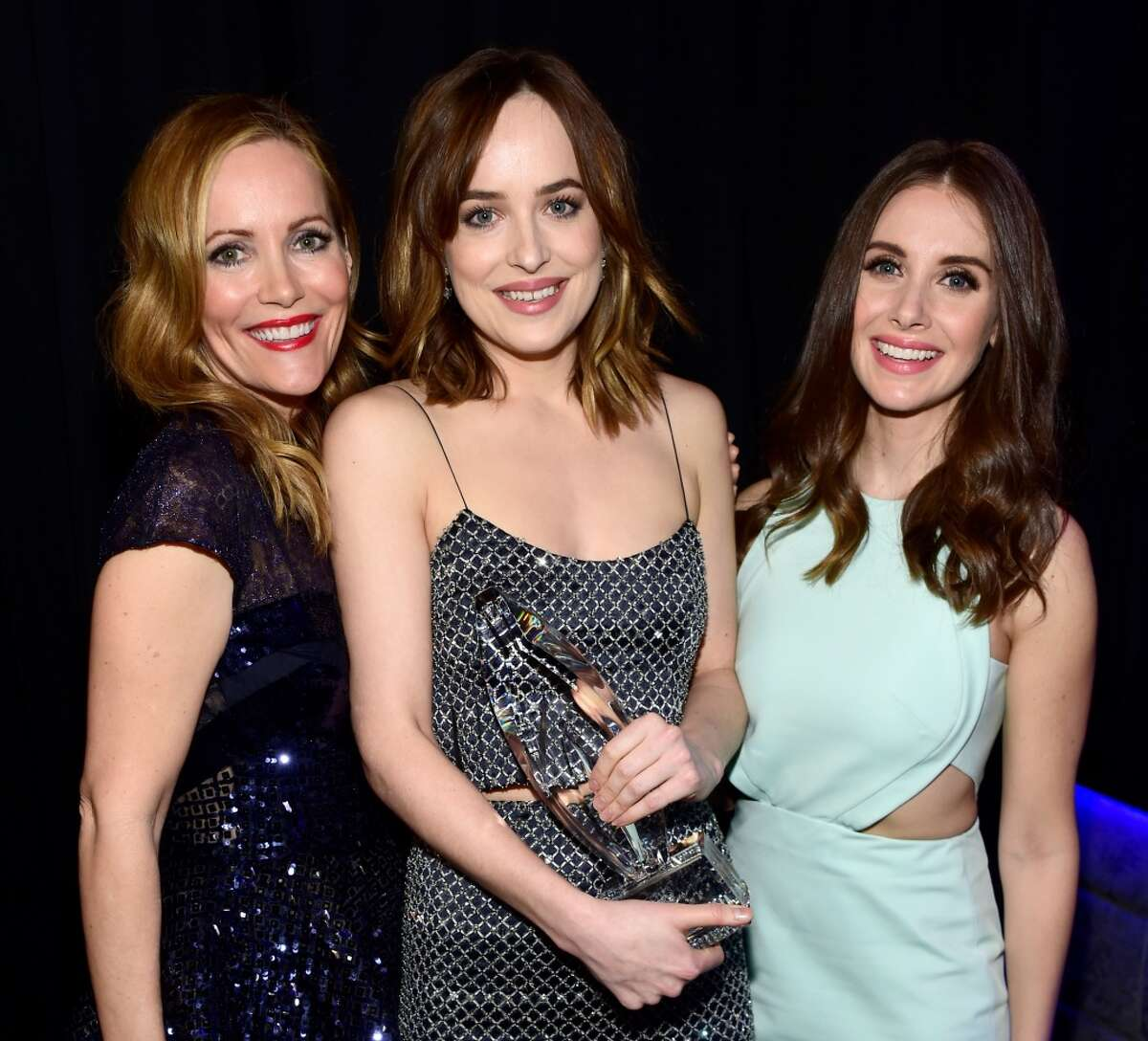 Actress Dakota Johnson (C), wearing Cartier jewelry, and actresses Leslie Mann (L) and Allison Brie attend the People's Choice Awards 2016 at Microsoft Theater on Jan. 6, 2016 in Los Angeles, Calif.