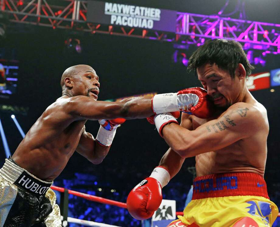 In this Saturday, May 2, 2015, file photo, Floyd Mayweather Jr., left, connects with a right to the head of Manny Pacquiao, from the Philippines, during their welterweight title fight in Las Vegas. Mayweather was one of the hottest topics on Facebook in 2015. Photo: John Locher /Associated Press / AP