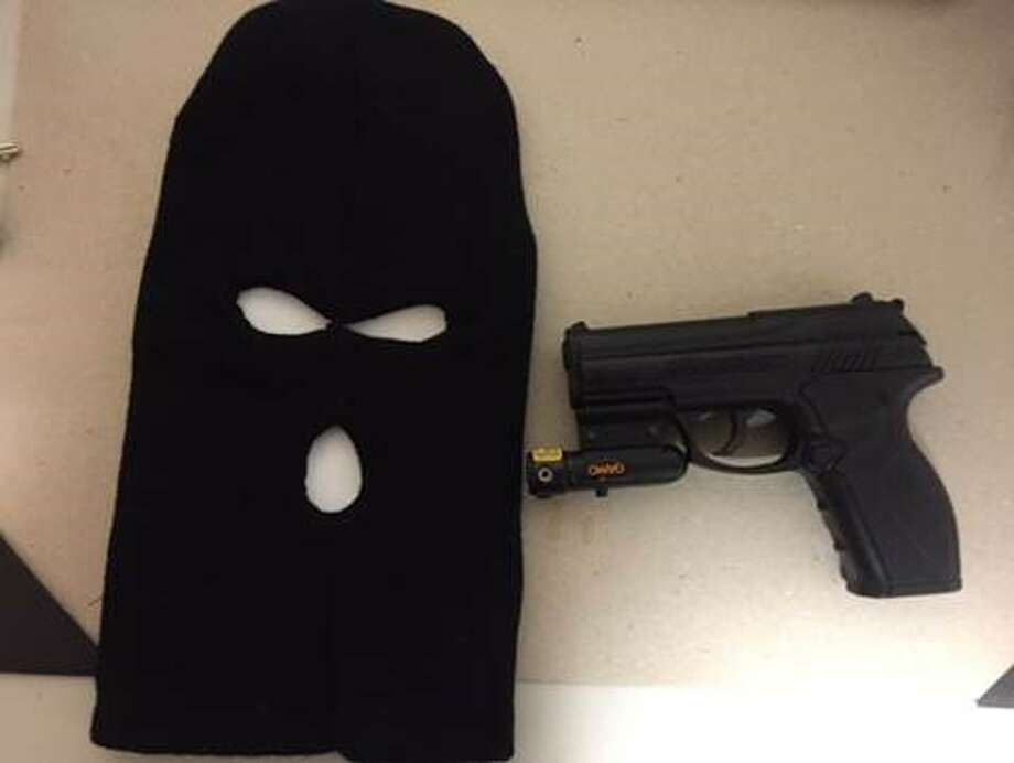 The mask worn by Deandre Parsons, 18, of Stamford, and the gun found in his possession Tuesday night. Parsons as charged with possession of a facsimile firearm after he was stopped while wearing a ski mask in the South End Tuesday night. Photo: Contributed Photo / Stamford Police / Stamford Advocate Contributed