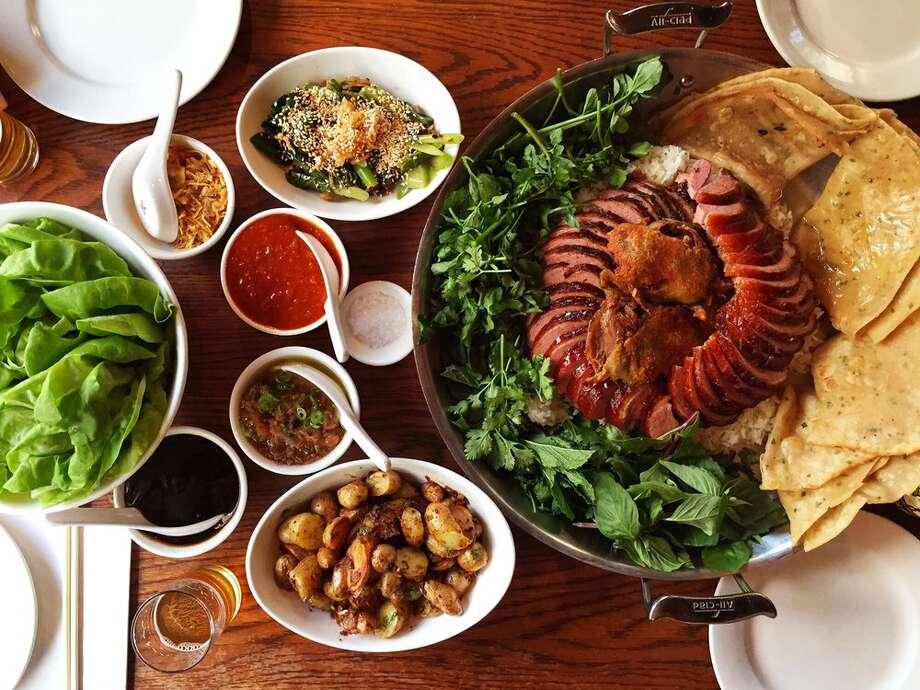 Roasted pork for sharing at Momofuku Ssam Bar in New york. Photo: Courtesy Yelp