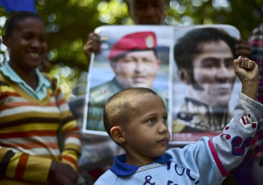 Mid-January, 2016: Venezuelan protesters call for the removal of images of Chávez and Bolívar. Photo: RONALDO SCHEMIDT, AFP / Getty Images