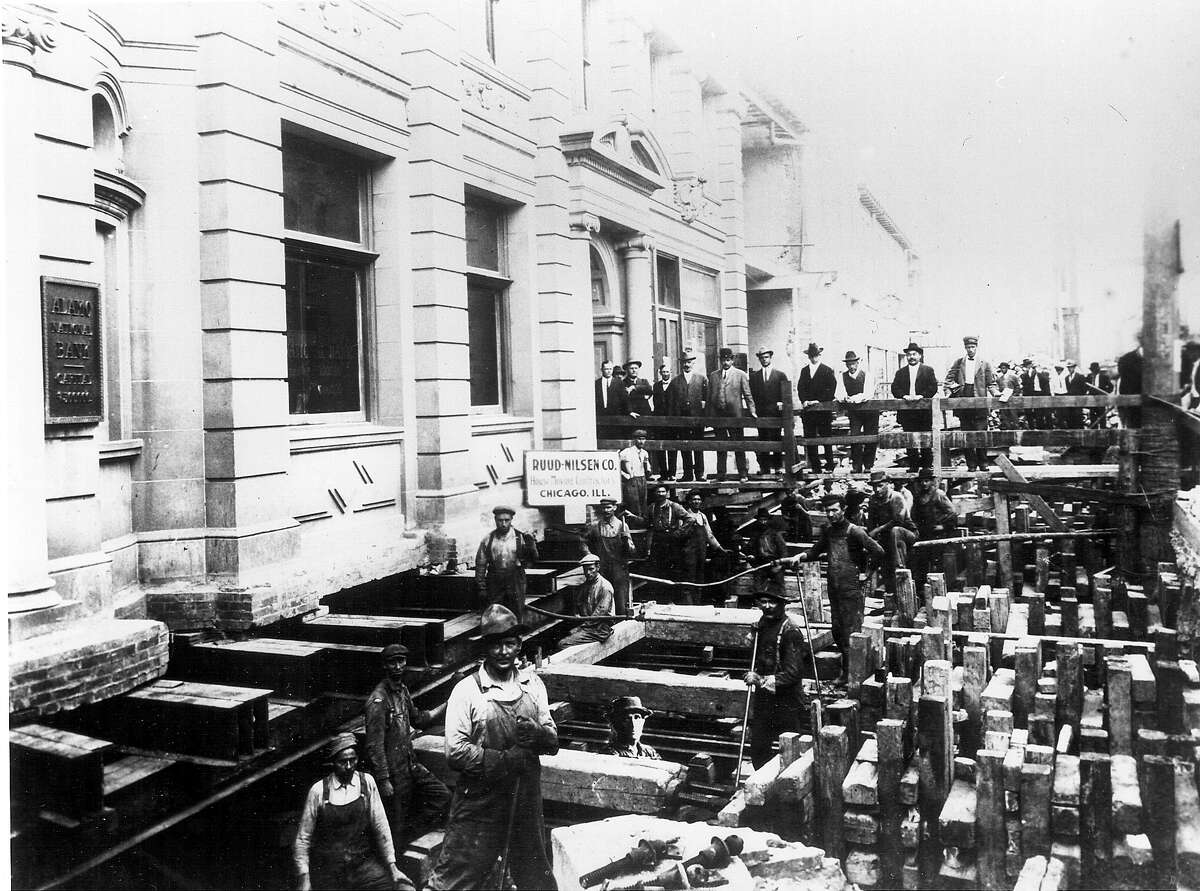 The original Alamo National Bank Building: Commerce Street merchants financed its widening in 1912, and construction workers moved the building back 15 feet, as seen in this picture. Legend has it banking services were not disrupted.