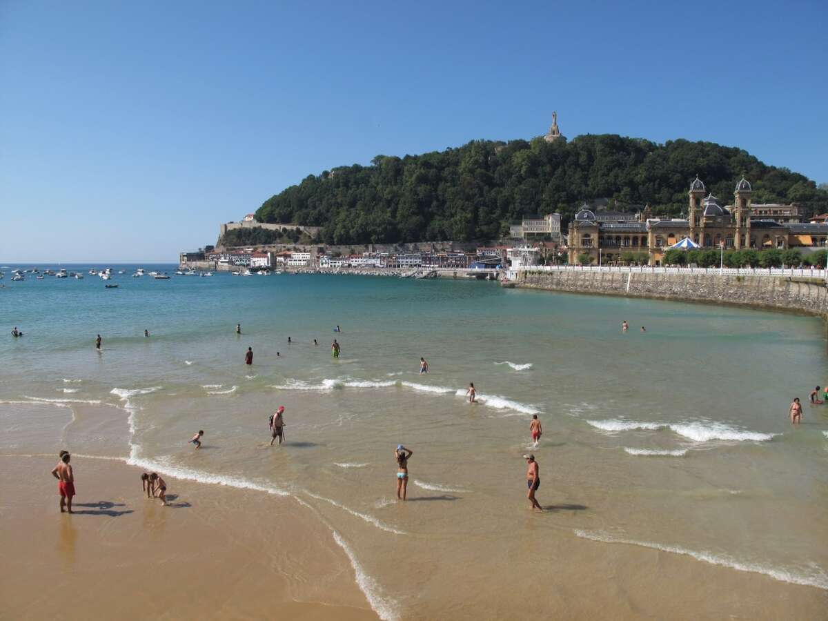 San Sebastian, Spain La Concha beach with the town hall and the harbor at the foot of Monte Urgull, San Sebastian, Basque Country, Spain.