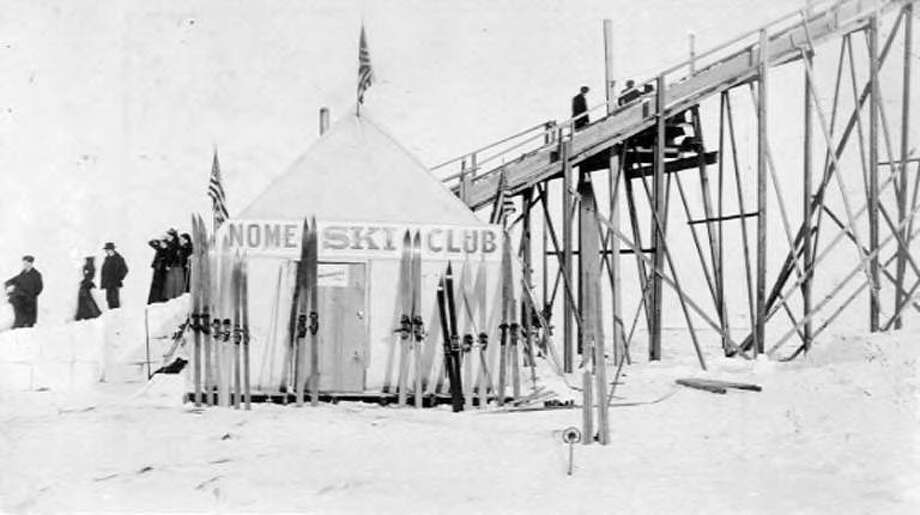 "A view of the Nome Ski Club tent, set up next to what is described in the original caption as a ""ski lift,"" though it appears to be only a ramp. The photo is dated between 1900 and 1920. Photo: Courtesy University Of Washington Special Collections"