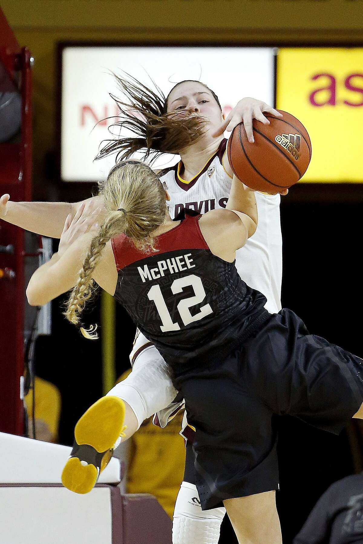 Arizona State's Sophie Brunner, right, blocks the shot of Stanford's Brittany McPhee, left, during the second half of an NCAA college basketball game Monday, Jan. 4, 2016, in Tempe, Ariz. Arizona State won 49-31. (AP Photo/Ross D. Franklin)