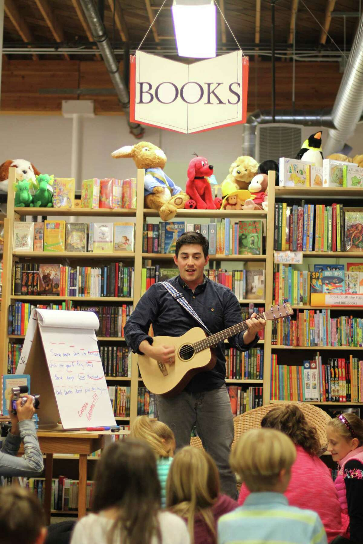 Danny Tieger performing at a book signing event for his recently-published