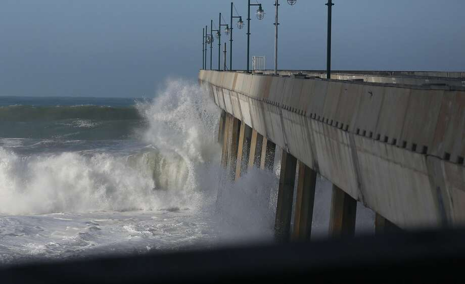 Big waves crash into the pier in Pacifica pier on Thursday, Jan. 7, 2015. Photo: Amy Osborne, Special To The Chronicle