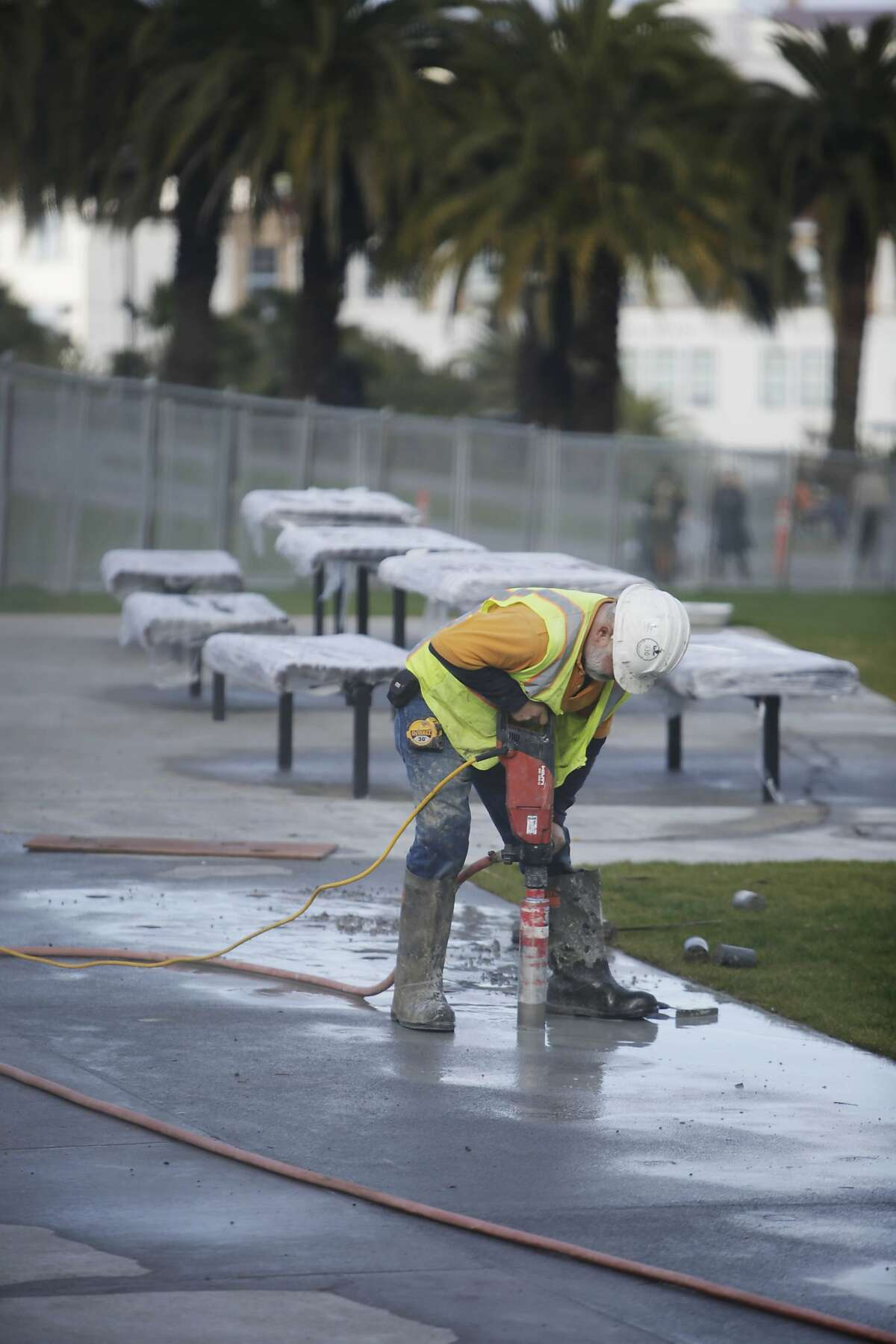 Rodolfo Vargas, Bauman laborer, makes holes for the new bike rack during the renovation of the south side of Dolores Park on Thursday, January 7, 2015 in San Francisco, Calif.