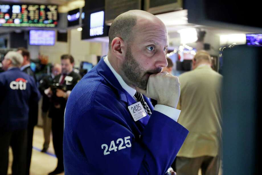 Specialist Meric Greenbaum works on the floor of the New York Stock Exchange on Thursday. Worries about China's economy and dropping oil prices helped fuel the worst one-day drop on Wall Street since late September. Photo: Richard Drew /Associated Press / AP