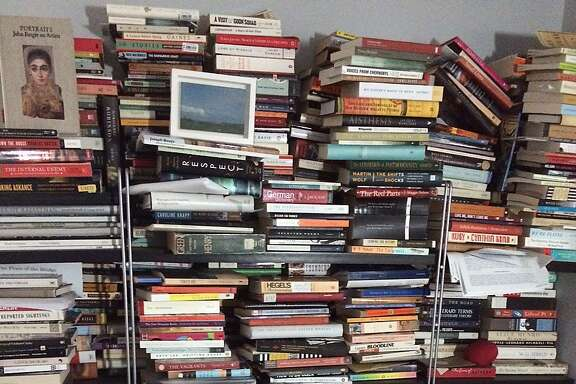 My bookshelves before using the Kondo cleaning method.
