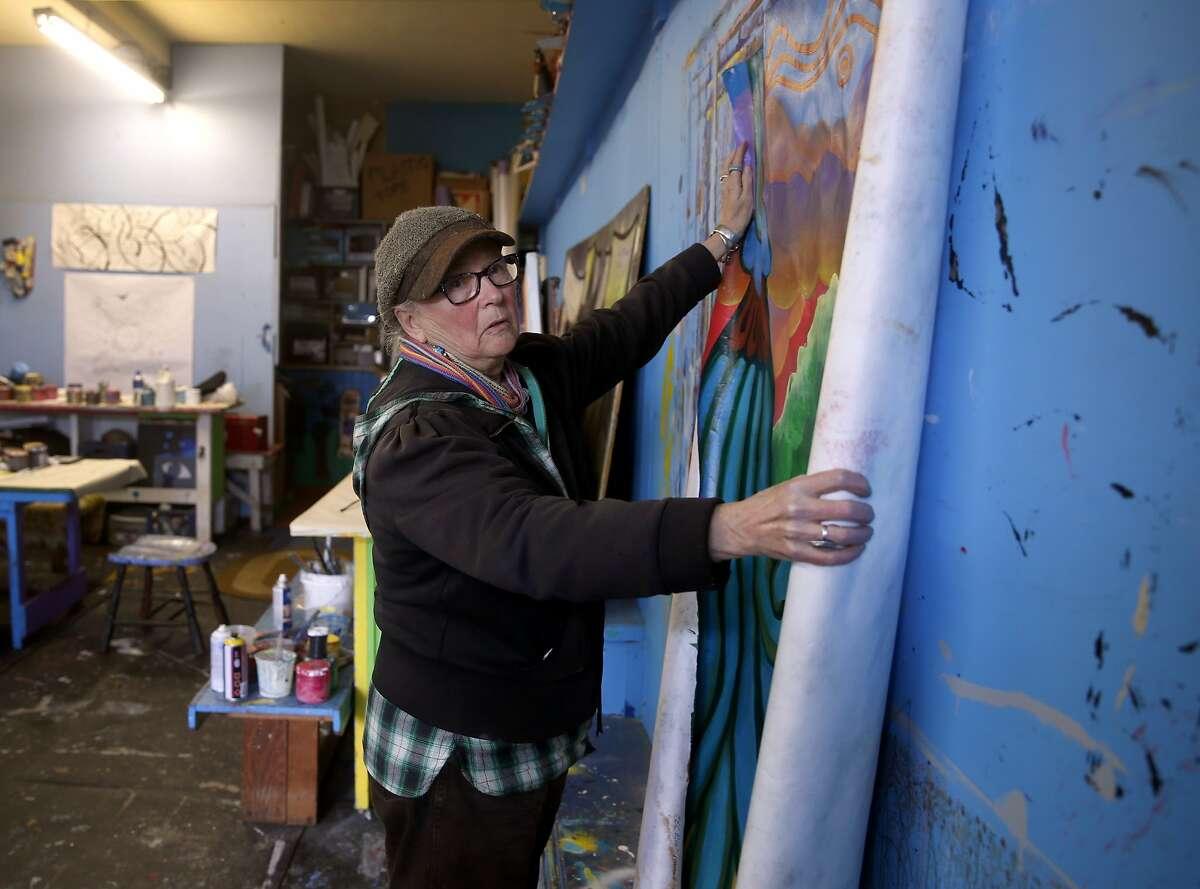 Precita Eyes founder Susan Cervantes unrolls a mural at the group's longtime studio in San Francisco, Calif. on Thursday, Jan. 7, 2016.