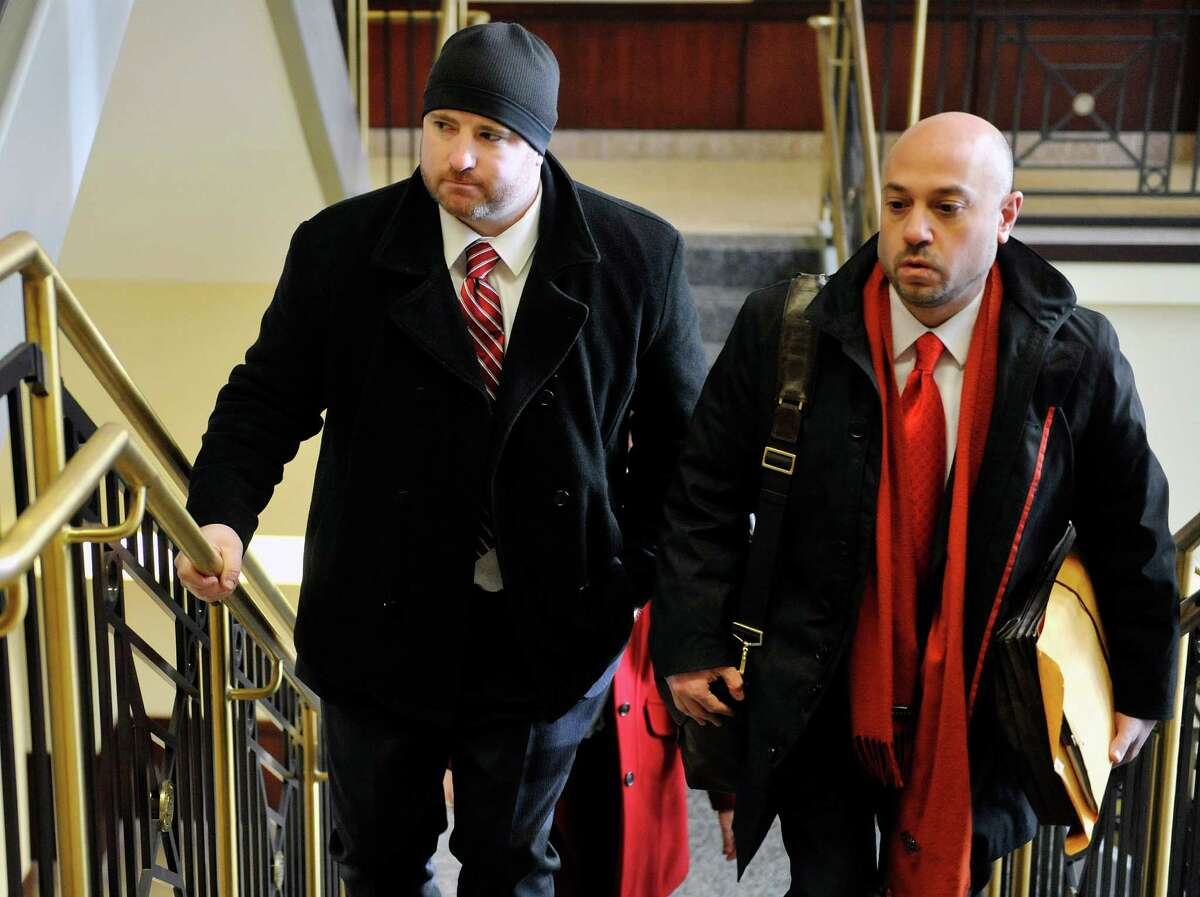 Joshua Spratt, left, walks in with his attorney Andrew Safranko at the Albany County Judicial Center for his sentencing on Thursday, Jan. 7, 2016, in Albany, N.Y. (Paul Buckowski / Times Union)