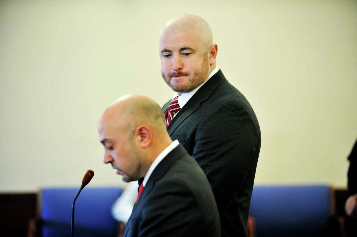 Joshua Spratt, background, stands with his attorney Andrew Safranko at the Albany County Judicial Center for his sentencing on Thursday, Jan. 7, 2016, in Albany, N.Y. (Paul Buckowski / Times Union)