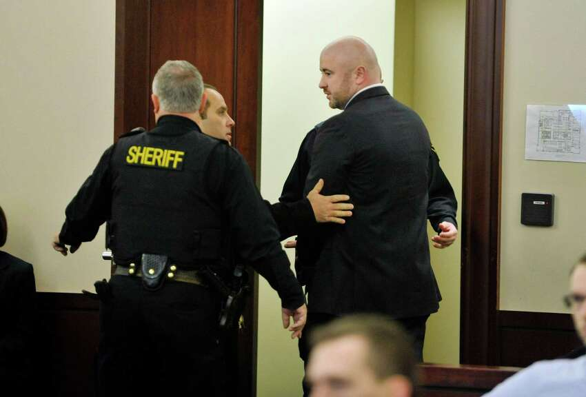 Joshua Spratt, right, is taken into custody following his sentencing at the Albany County Judicial Center on Thursday, Jan. 7, 2016, in Albany, N.Y. (Paul Buckowski / Times Union)