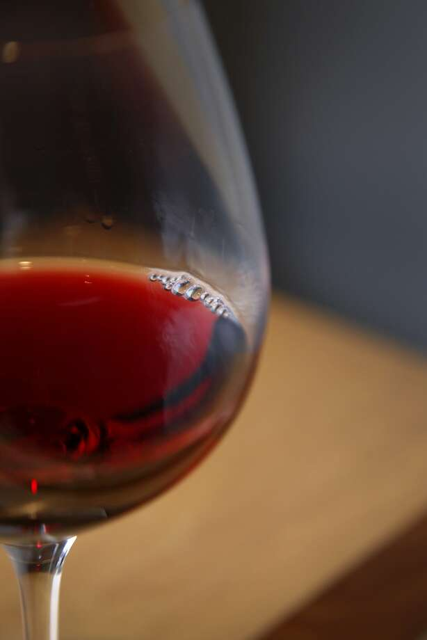 A glass of pinot at Cartograph Wines tasting room in Healdsburg, Calif., on Saturday, January 2, 2015. Photo: Preston Gannaway, Special To The Chronicle