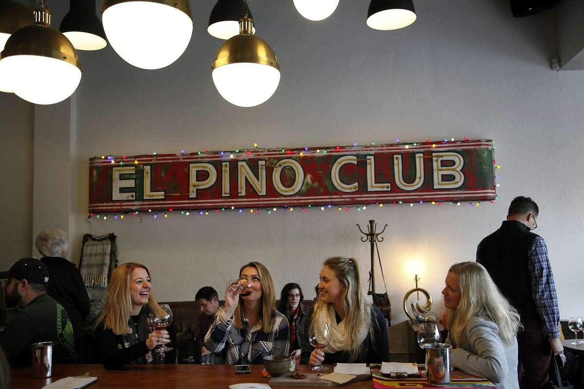 People enjoy wine at Banshee's tasting room in Healdsburg, Calif., on Saturday, January 2, 2015.