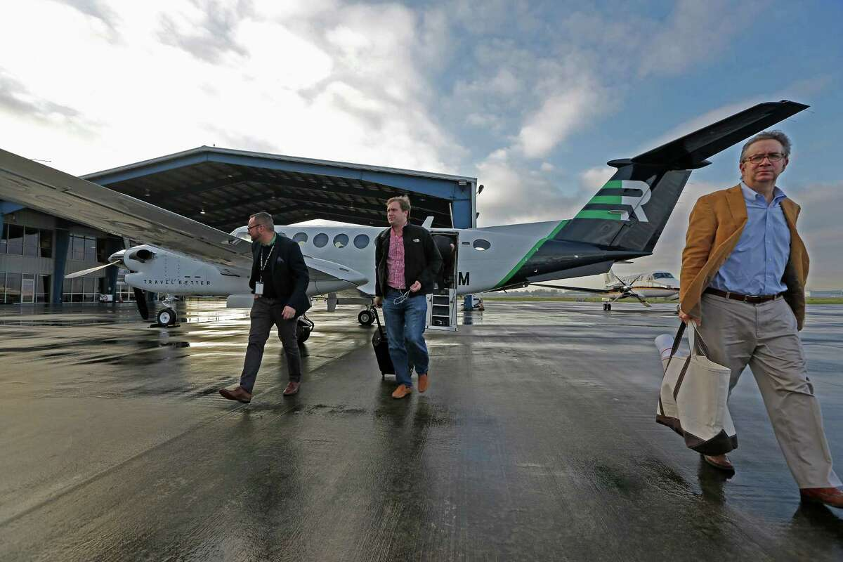 Passengers depart from a Rise aircraft Thursday, Jan. 7, 2016, in Houston. Rise is a Dallas-based company where members pay a monthly fee to share a private jet for scheduled flights between cities such as Houston and Dallas. ( Steve Gonzales / Houston Chronicle )