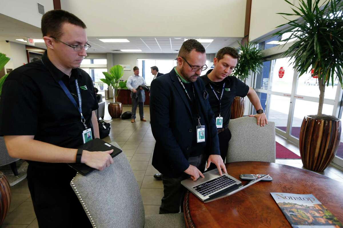 Rise pilots Ryan Weeditz, left, and Justin Williams go over flight information with Cooper Johnson at Hobby Airport. The Dallas-based air service plans to add flights to San Antonio this quarter.