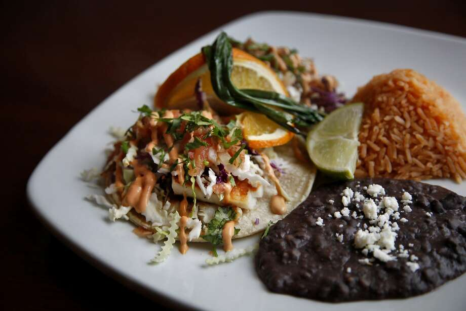 The seasonal fish taco at El Farolito, which has been in business for almost 40 years and offers unique specialties. Photo: Preston Gannaway, Special To The Chronicle