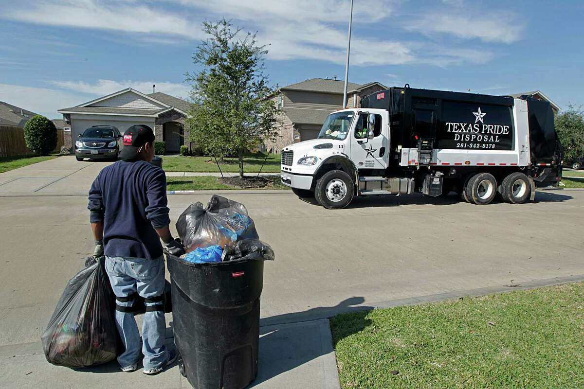 Texas Pride Disposal crew picks up trash in the River's Run subdivision Tuesday, Jan. 5, 2016, in Richmond. ( James Nielsen / Houston Chronicle )