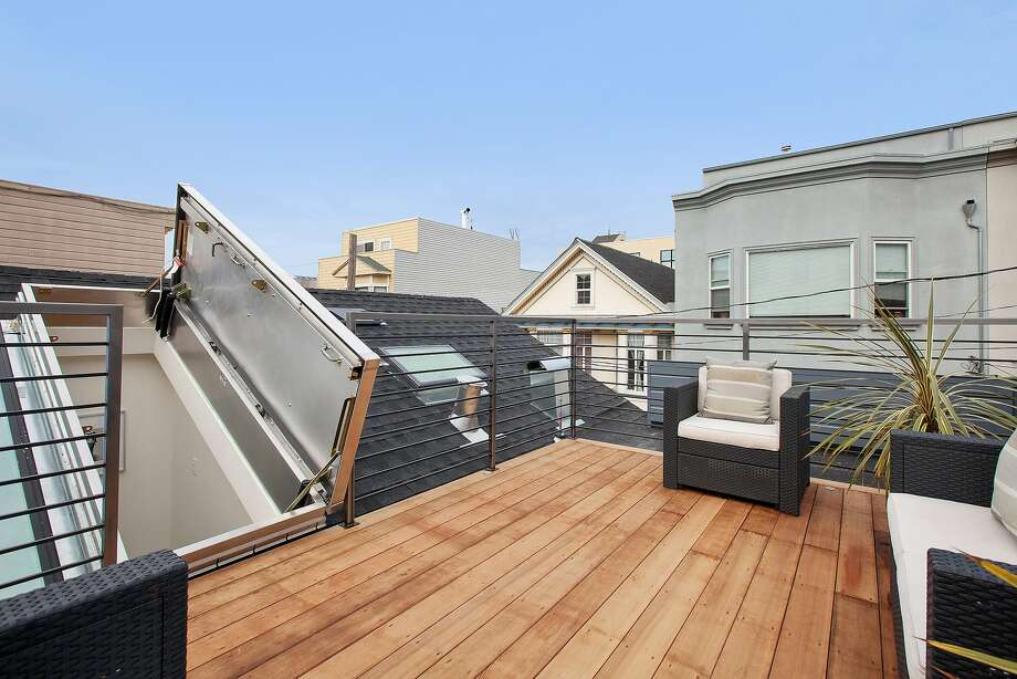 An skylight in the master suite opens to a private roof terrace with neighborhood views. Photo: Olga Soboleva / Vanguard Propert