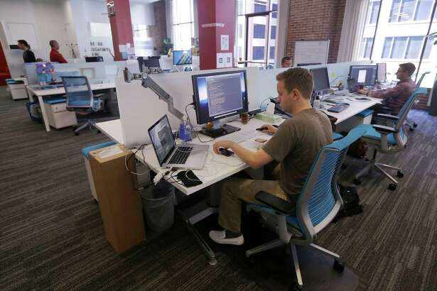 Workers on the job at the Target Technology Innovation Center office in San Francisco. A survey says millennials are saving a median of 7.5 percent of their pay.