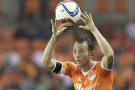 "Longtime Dynamo midfielder Brad Davis describes his trade to Sporting KC as ""bittersweet."" Despite strong ties to Houston, he'll now be closer to home."