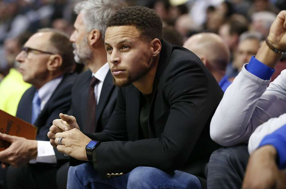 Golden State Warriors' Stephen Curry watches from the bench during the second half an NBA basketball game against the Dallas Mavericks, Wednesday, Dec. 30, 2015, in Dallas. Curry missed the game due to an injury. The Dallas Mavericks won 114-91. Photo: Jim Cowsert, Associated Press