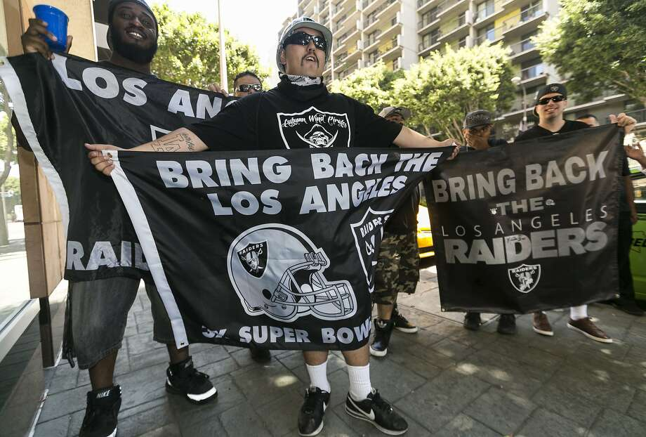 FILE - In this Aug. 17, 2015, file photo, Los Angeles Raiders fans cheer outside a hotel where former NFL executive Carmen Policy, not seen, introduced a proposed new $1.7-billion NFL football stadium to members of the Los Angeles Sports Council, in downtown Los Angeles. The NFL's owners could take a significant step toward the league's return to Los Angeles this week. Or they could decide to take another big step back. Nobody seems certain of the next move in this exhausting dance when the full ownership convenes Wednesday for its annual meetings at a luxury resort outside Dallas. (AP Photo/Damian Dovarganes, File) Photo: Damian Dovarganes, Associated Press
