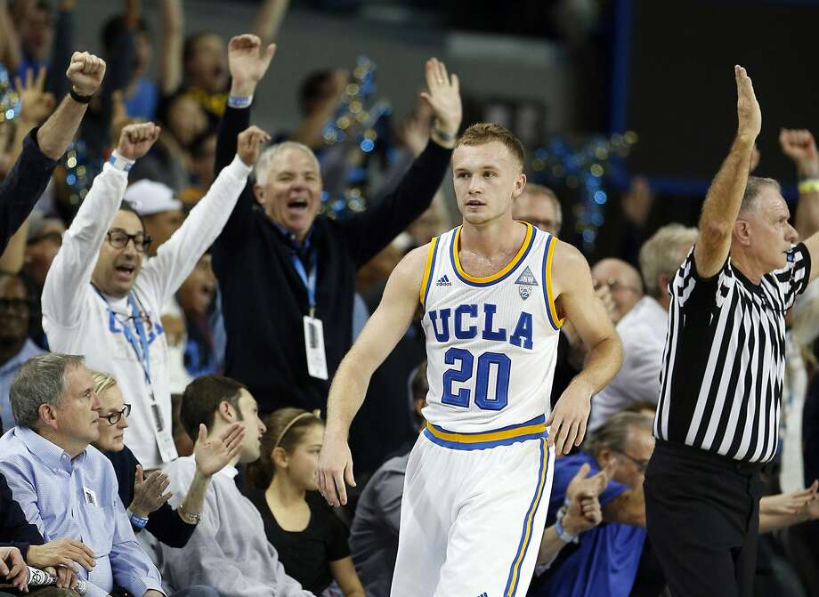 UCLA fans cheer after Bryce Alford hits a late three-pointer to upend No. 7 Arizona. Photo: Robert Gauthier, McClatchy-Tribune News Service