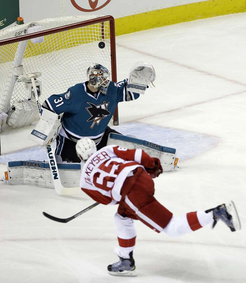 Danny DeKeyser fires a first-period shot past Sharks goalie Martin Jones to give Detroit a 1-0 lead. San Jose fell to 0-12 at home when its opponent scores first. Photo: Marcio Jose Sanchez, Associated Press