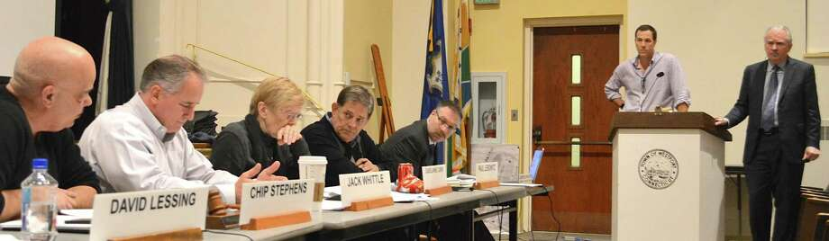 """Planning and Zoning Commission Chairman Chip Stephens, far left, questions developer David Waldman and lawyer William Fitzpatrick about their propsed """"Riverwalk District"""" zoning amendment, which is designed to permit redevelopment of the former Save the Children property on Wilton Road. Photo: Jarret Liotta / For Hearst Connecticut Media / Westport News"""